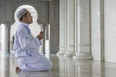 Religion concept. Asian muslim man praying Stock Image