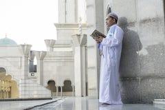 Religion concept. Asian muslim man praying Stock Photos