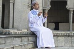 Religion concept. Asian muslim man praying Stock Photography