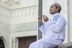 Religion concept. Asian muslim man praying Royalty Free Stock Images