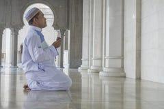 Religion concept. Asian muslim man praying Royalty Free Stock Photography