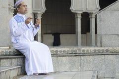 Religion concept. Asian muslim man praying Royalty Free Stock Photos