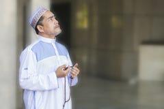Religion concept. Asian muslim man praying Stock Images