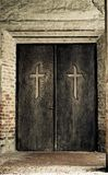 Religion concept - cross on door Stock Photography