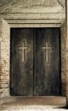 Religion concept - cross on door. Cross on spooky church door. Worship concept Stock Photography