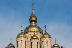 Gold cupola of the church on the blue sky background. Royalty Free Stock Image