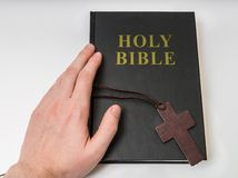 Religion concept. Hand touches Holy Bible Royalty Free Stock Image