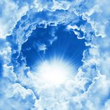Religion concept of heavenly background. Divine shining heaven with dramatic clouds, light. Sky with beautiful cloud and sunshine