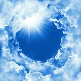Religion concept of heavenly background with dramatic clouds. Divine shining heaven, light. Sky with beautiful cloud and sunshine