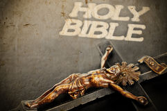 Religion conceptual image. With cross and holy bible Stock Images