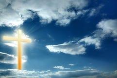 Religion cross. On the blue sunny sky, heaven Royalty Free Stock Photo