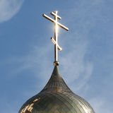 Religion cross on church dome Stock Photo