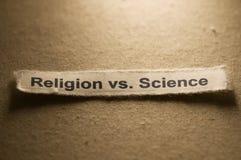 Religion gegen Wissenschaft lizenzfreies stockfoto
