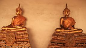 Religion. Golden Buddhas Image With Mortar Walls. Religion. Smilingly Golden Buddhas Image symbol and traditional of Buddhism  in Bangkok Thailand Stock Photo