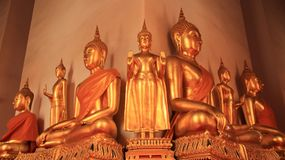 Religion. Golden Buddhas Image. Symbol and traditional of Buddhism  in Bangkok Thailand Stock Photography