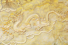 Religion golden relief of dragon Stock Photo