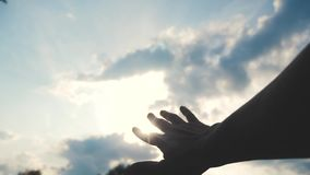 Religion hand concept on blue sky background. the man hand stretches to god faith and bliss lifestyle stock video