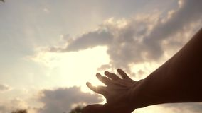 Religion hand concept on blue sky background. The man hand stretches to god faith lifestyle and bliss