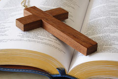 Religion II. Close up of a wooden cross on a bible Royalty Free Stock Photography