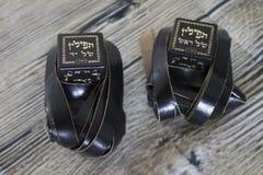 Religion Jewish objects on woody background. Tallit & tefillin stock photos