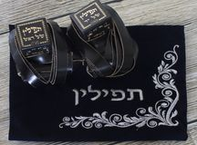 Religion Jewish objects on woody background. Tallit & tefillin stock images