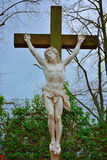 Religion, jezus hanging on a wooden cross. Religion, sculpture of jezus hanging on a wooden cross Stock Image