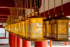 Religion Lamp Shitennoji Temple in Osaka, Japan. It`s meaning the light of Buddha. Many lamp hang on the top Royalty Free Stock Photo