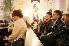 Religion. LUTSK, UKRAINE - 24 May 2008: Religious scene people praying at local church Stock Image