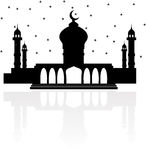 Religion mosque with Crescent moon and stars and a reflection Royalty Free Stock Photos