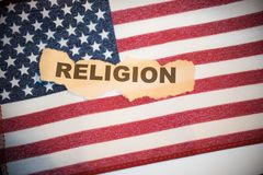 Religion on old torn paper laying on top of American Flag Royalty Free Stock Photography
