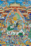 Religion painting of Tibet, China. Tibet culture, traditional artwork as painting, named Tangka, with Buddha and religion symbol Stock Image
