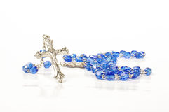 Religion and pray symbol rosary isolated on the bright background Royalty Free Stock Photos