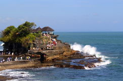 Religion and recreation. Atmosphere at tanah lot bali, fun, recreation and pray ritual Stock Photography