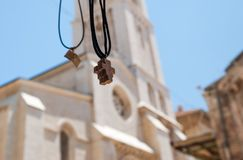 Religion souvenirs on Lutheran Church of the Redeemer background. Jerusalem. Israel royalty free stock image