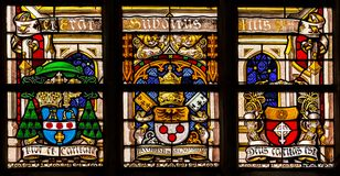 Religion stained-glass in the cathedral of Gent, Flanders, Belgium Stock Images