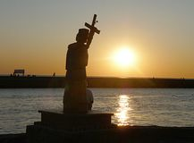 Religion statue and sea. Old religion statue and sea Royalty Free Stock Photography