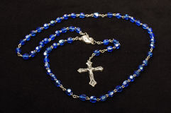 Religion symbol Dominican rosary on the black background Royalty Free Stock Images