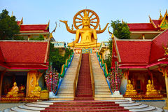 Religion, Thailand. Wat Phra Yai, Big Buddha Temple At Samui. Religion In Thailand. Golden Statue Of Buddha With Dragon Staircase In Wat Phra Yai, The Big Royalty Free Stock Photo