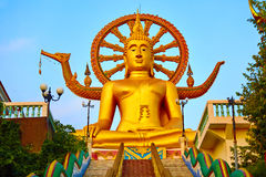 Religion, Thailand. Wat Phra Yai, Big Buddha Temple At Samui. Religion In Thailand. Golden Statue Of Buddha With Dragon Staircase In Wat Phra Yai, The Big Stock Photo