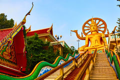 Religion, Thailand. Wat Phra Yai, Big Buddha Temple At Samui. Religion In Thailand. Golden Statue Of Buddha With Dragon Staircase In Wat Phra Yai, The Big Royalty Free Stock Image