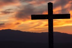 Religion theme, catholic cross and sunset stock image
