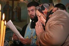 Religion. VOYUTYN, UKRAINE - 14 October 2008: Priest and Ukrainian parishioners of the Orthodox Church during the religious celebration Pokrov Stock Image