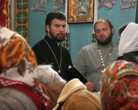 Religion. VOYUTYN, UKRAINE - 14 October 2008:  Priests and parishioners of the Orthodox Church during the religious celebration Pokrov Royalty Free Stock Images