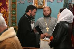 Religion. VOYUTYN, UKRAINE - 14 October 2008:  Priests and parishioners of the Orthodox Church during the religious celebration Pokrov Stock Images