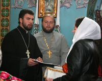 Religion. VOYUTYN, UKRAINE - 14 October 2008:  Priests and parishioners of the Orthodox Church during the religious celebration Pokrov Stock Photography