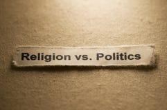 Religion vs Politcs. Religious concept with paper and with words Religion vs Politics on it Royalty Free Stock Photos