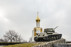 Religion_war. A tank in front of a church in Tiraspol royalty free stock photography