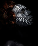 Religion. Worship. Black female in ceremonial mask Royalty Free Stock Photography
