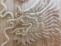Religione di simboli del segno di anno cinese dell'oro del drago la nuova alimenta la scultura del capo Fotografie Stock Libere da Diritti