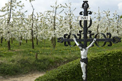 Religiosity, economy and nature in rural landscape. Netherlands: in the south of the province Limburg, in the village Sint Geertruid is a Christ statue, crucifix Stock Photos